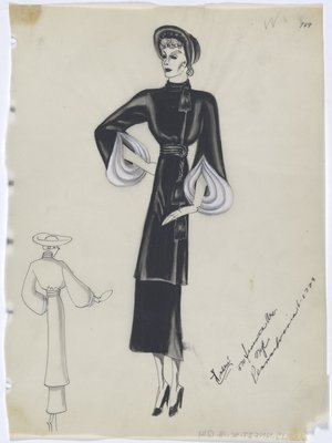 Black Coat with Tassels, with White Fur along Sleeve, Worn with Black Hat, Skirt and Shoes