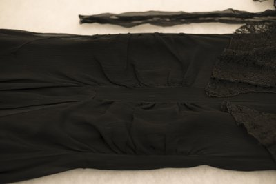 Black chiffon dress with lace, detail of front, 1929