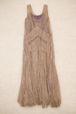 Evening dress with a silver and purple openwork novelty weave and purple slip, front view, 1927