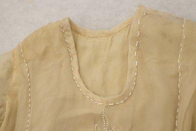 White beaded wedding style dress, neckline detail, 1915