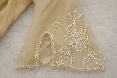 White beaded wedding style dress, sleeve detail, 1915