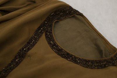 Brown chiffon dress with beading, neckline detail, circa 1926-1928