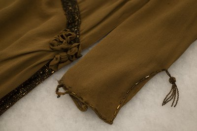 Brown chiffon dress with beading, wasteline and sleeve detail, circa 1926-1928