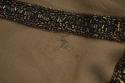 Brown chiffon dress with beading, beading detail showing deterioration, circa 1926-1928