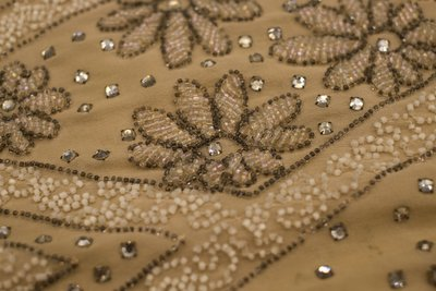 Beige beaded dress, detail view of beads and rhinestones, 1920s