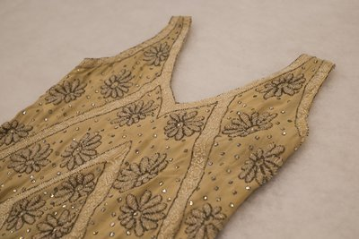Beige beaded dress, neckline detail, 1920s