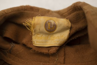 Brown wool coat, view of Frederick Loeser & Co. tag, 1920