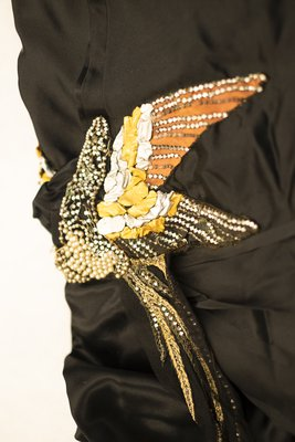 Black silk evening gown, detail view of side embellishments, 1921
