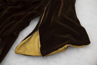 Brown velvet cowl neck dress, sleeve detail, undated