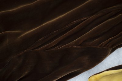 Brown velvet cowl neck dress, textile detail, undated