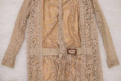 Peach lace dress and matching vest with flower details, front view detail, 1925