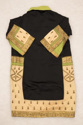 Black satin coat with green, pink, and gold embroidery, back view, 1920