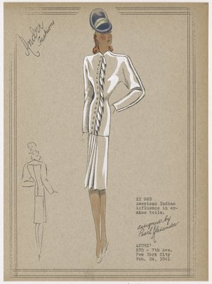 Suit with fur decoration and pleated skirt.