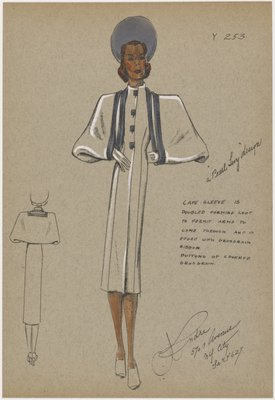 Fitted coat with cape sleeves.