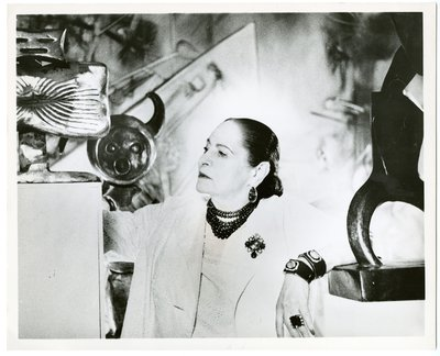 Helena Rubinstein with Max Ernst sculpture