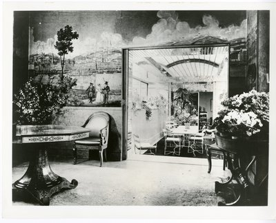 Room with townscape mural with figures in Paris apartment