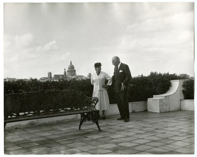 Helena Rubinstein and Artchil Gourielli on terrace with Paris cityscape