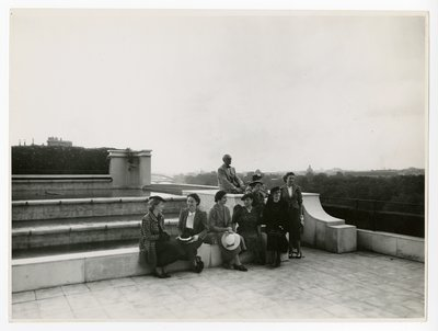 Women and man on terrace of Helena Rubinstein's Paris apartment
