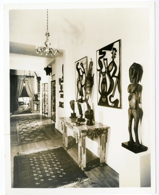 Foyer with primitive art and paintings in the Paris apartment