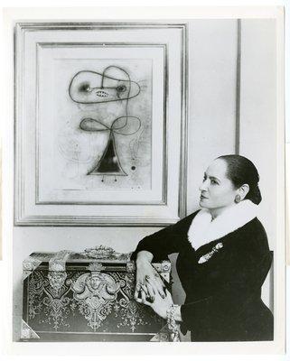 Helena Rubinstein wearing ermine trimmed velvet suit by Dior