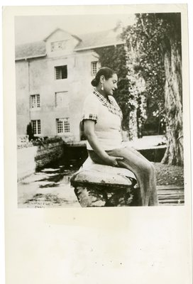 Helena Rubinstein on the banks of the mill stream at Moulin de Breuil country home