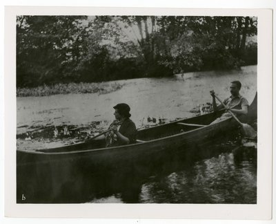 Helena Rubinstein and Oscar Kolin in a canoe at the Moulin de Breuil