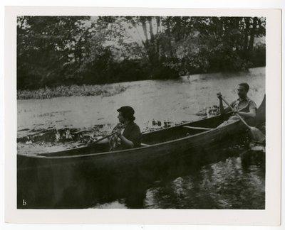 Helena Rubinstein and Oscar Kolin in a canoe at the Moulin de Breuil