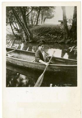 Helena Rubinstein in a canoe at the Moulin de Breuil