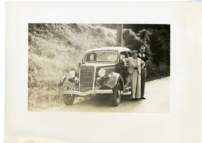 Helena Rubinstein and Roy Titus by car on side of country road