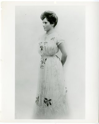 Helena Rubinstein, age 18, in embroidered gown by Charles Worth