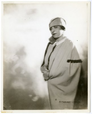Helena Rubinstein in long cape by Poiret with cloche