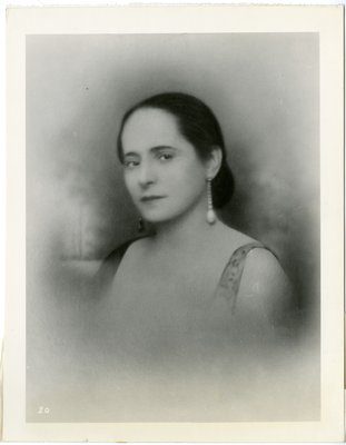 Helena Rubinstein in Lanvin dress and mis-matched black and white earrings