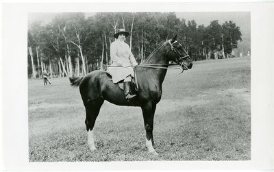 Young Helena Rubinstein in riding clothes and boots on a horse in Australia