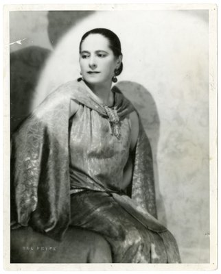 Helena Rubinstein in silk ensemble with cape by Poiret