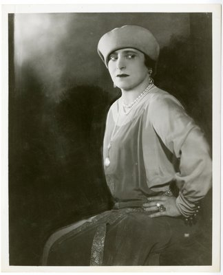 Helena Rubinstein in geometric ensemble with decorative cuff buttons