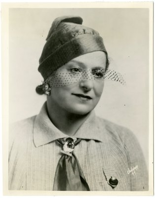 Helena Rubinstein in knit top with scarf pin in possible military style
