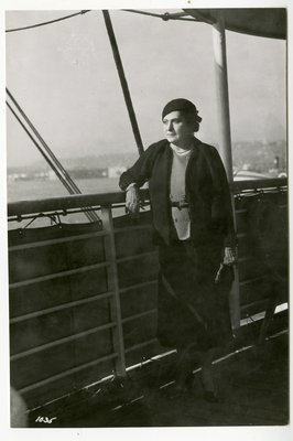 Helena Rubinstein in likely Chanel suit on the deck of a ship
