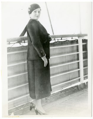 "Helena Rubinstein in Chanel ""tailleurs"" suit on the deck of a ship"