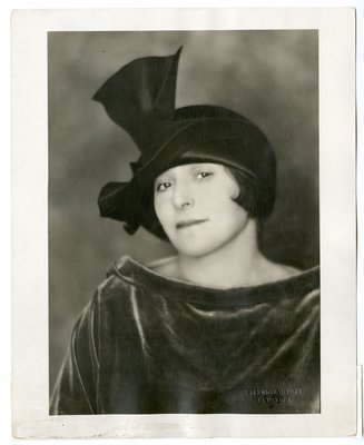 Helena Rubinstein in velvet boat neck ensemble by Caroline Reboux