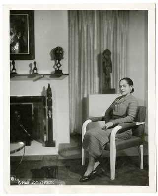 Helena Rubinstein with African art and portrait by Tchelitchew
