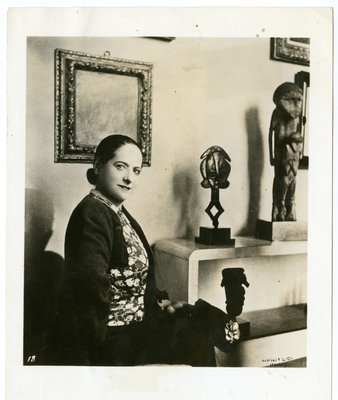 Helena Rubinstein in Molyneux three-piece suit with primitive art