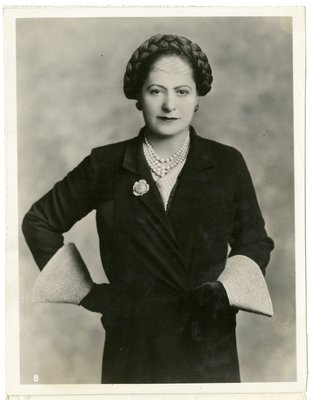Helena Rubinstein in trompe l'oeil braided hat and jacket with conical sleeves
