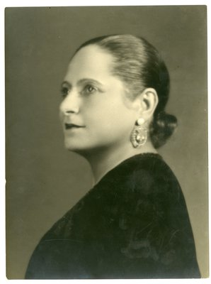 Helena Rubinstein in dark ensemble and diamond earrings
