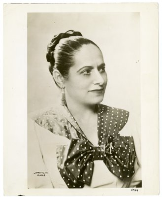Helena Rubinstein in ensemble with polka-dot bow