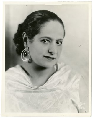 Helena Rubinstein in satin dress