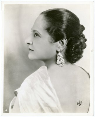 Helena Rubinstein in ensemble with exposed back