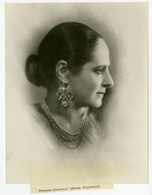 Helena Rubinstein in Schiaparelli blouse, pearls, and quatrefoil earrings