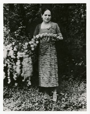 Helena Rubinstein in the garden of her summer home in Greenwich, CT