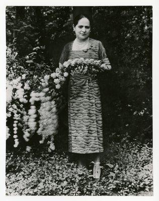 Helena Rubinstein in the garden of her summer home in Greenwich, CT
