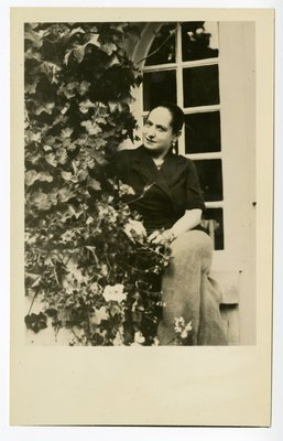 Helena Rubinstein sitting in window wiith climbing ivy